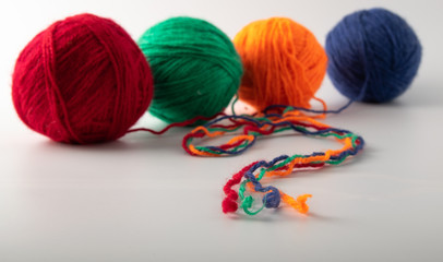 multicolored wool knitting balls in the basket. supplied on a light background