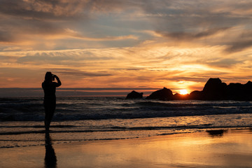 Photographing sunset on the beach