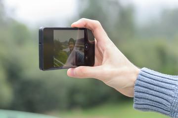 a man with a beard makes a selfie
