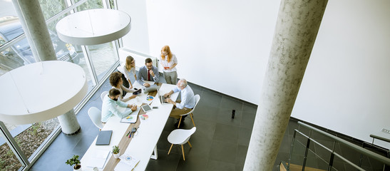 Top view at business people in office
