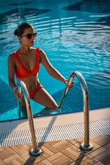 woman in bikini in swimming pool