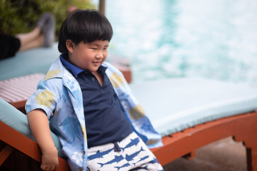boy waiting to play in swimming pool