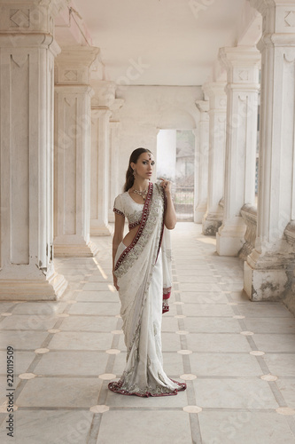 52588374c4 Beautiful young indian woman in traditional clothing with bridal makeup and oriental  jewelry. Eastern fairy tale