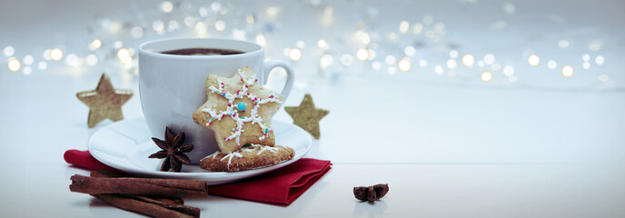 Christmas Cookie with garland and coffee cup.