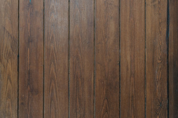 A few grungy ancient wooden planks in Spain. Wooden dark brown texture