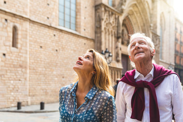 Senior couple of tourists visiting the old town in Barcelona