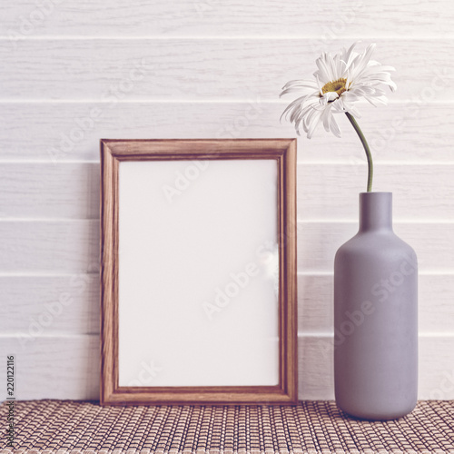 White Chamomile Is In A Gray Vase Nearby There Is An Empty Wooden