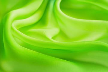folds bright yellow green transparent fabric