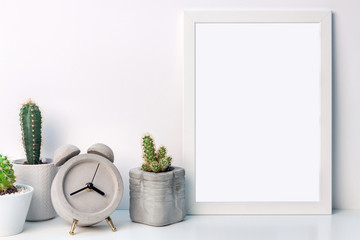 White mockup frame with cactuses and a round concrete clock on a white background