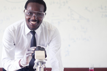 African scientist  Using Microscopes In Laboratory