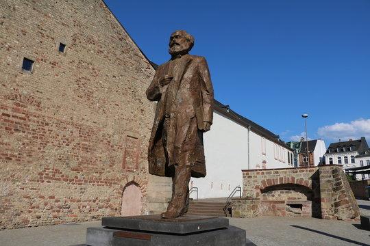 Karl Marx statue monument on the Simeonstiftplatz in Trier, Germany