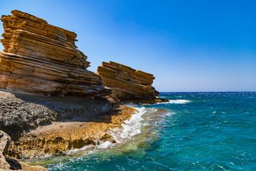 Triopetra beach with sea and stones. Summer 2018. Crete, Greece.