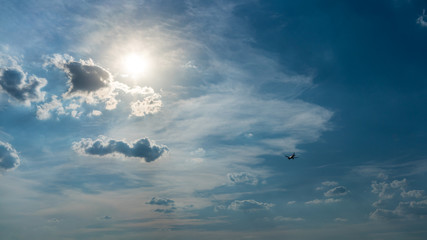Plane flying into the sun, holiday travel