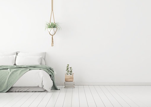Home bedroom interior mockup with bed, green plaid, pillows and plants on empty white wall background. Free space on right. 3D rendering.