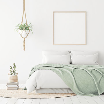 Poster mockup with wooden square frame on empty white wall in bedroom interior with bed, green plaid, rug and plants. 3D rendering.