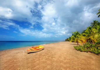 Travel Caribbeans. Beautiful Beach in Martinique Island. Small boat on the beach. Grande Anse Le Coin Beach, Le Carbet.