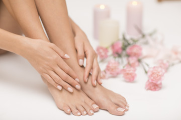 Poster de jardin Manicure The picture of ideal done manicure and pedicure. Female hands and legs in the spa spot.