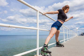 Joyful teen girl wearing roller skates