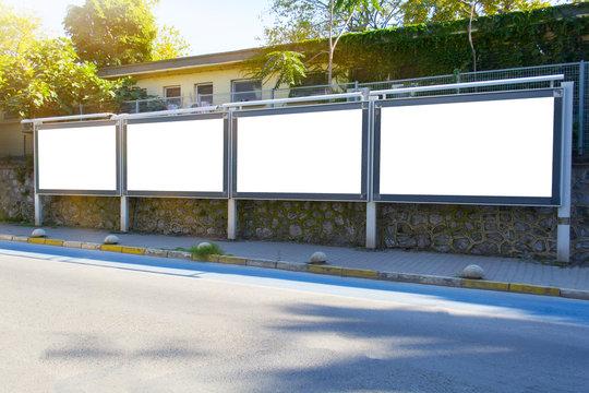 Blank white mockup four billboard in empty Istanbul street