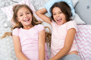 pajama party and friendship. pajama party of two happy small kids in bedroom. friendship of small kids girls with happy faces. yeah