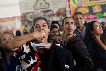 A woman eats a piece of a giant Torta weighing 865 kg (1907 lbs) and 70-meters (230 feet) long according to the organizers, during an attempt at the world's biggest sandwich, in Mexico City