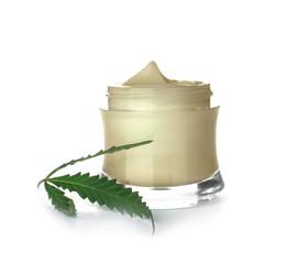Jar with hemp lotion on white background