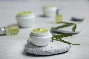 Jar of moisturizing hemp lotion on table