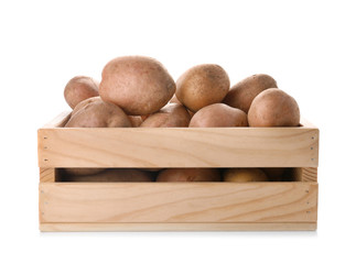 Wooden crate with fresh ripe organic potatoes on white background