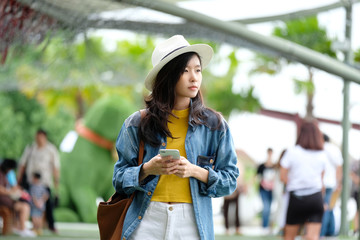 Young asian woman using smart phone in city outdoors background, people on phone, lifestyle