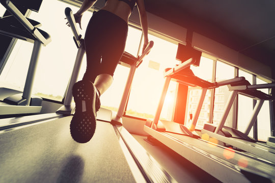 Exercise treadmill cardio running workout at fitness gym of woman taking weight loss with machine aerobic for slim and firm healthy in the morning.