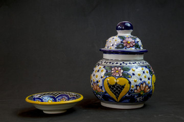 Talavera vase with a playful plate