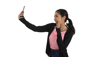 Cute asian girl in casual cloth holding mobile phone and take selfie.