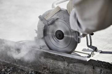 Man cutting a Concrete Slab with a circular saw