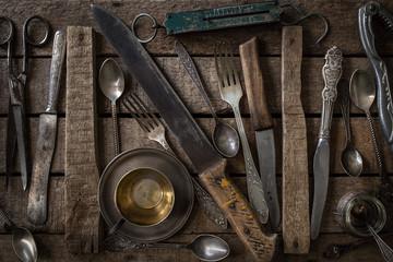 Vintage cutlery on dark rustic  background. top view