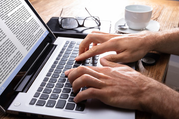 Close-up Of A Person Typing On Laptop