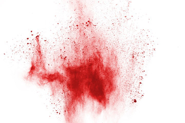 Freeze motion of red powder exploding, isolated on white background. Abstract design of red dust cloud. Particles explosion screen saver, wallpaper