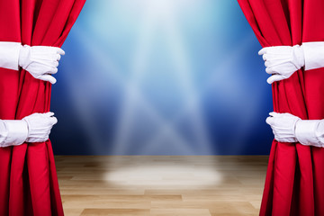 Two People Opening Red Stage Curtain