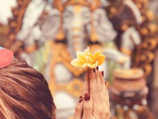 Woman praying Lord Ganesha.