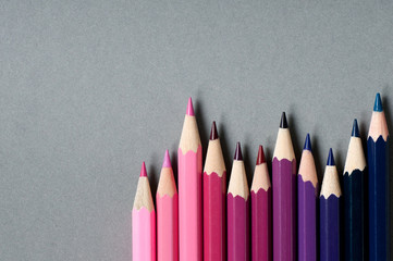 Color pencils isolated on grey background.