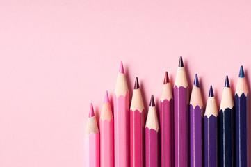Color pencils isolated on pink background.