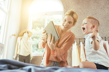 Mother and son shocked with ammount of sales on family clothing store website