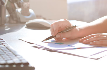 close up. business woman checks financial report