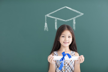 happy girl in graduation cap  with education concept