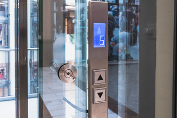 Elevator buttons control panel in modern business building or Mall or shopping center, close up
