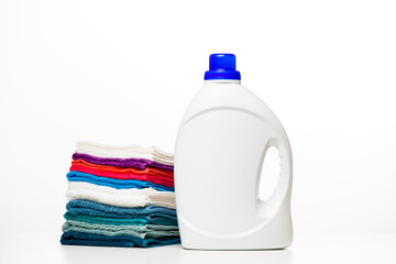 Photo of one bottles of cleansers and colorful towels