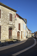 Empty streets on a sunny early summer afternoon in rural Hautefage la Tour village, Lot et Garonne, France