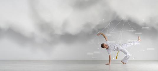 Man practicing Capoeira , brazilian martial Art. Sport science, biomechanics, information technology concept
