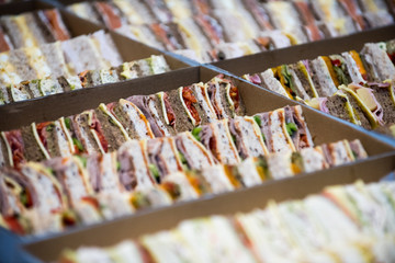 sandwiches cut in to triangles served as catering at an event