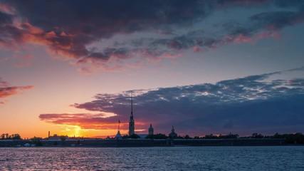 Fotobehang - Hyperlapse of sunset over Peter and Paul Fortress skyline silhouette in Saint Petersburg, Russia. 4K UHD timelapse.