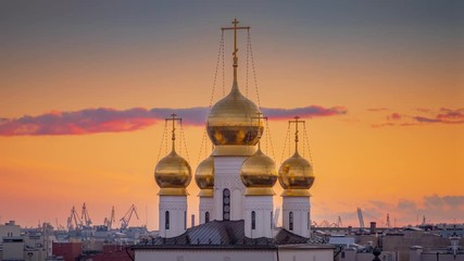 Fotobehang - Onion domes of Russian Orthodox Church The Cathedral of the Feodorovskaya Icon of Our Lady in Saint Petersburg, Russia at sunset. 4K UHD Timelapse, zoom out.